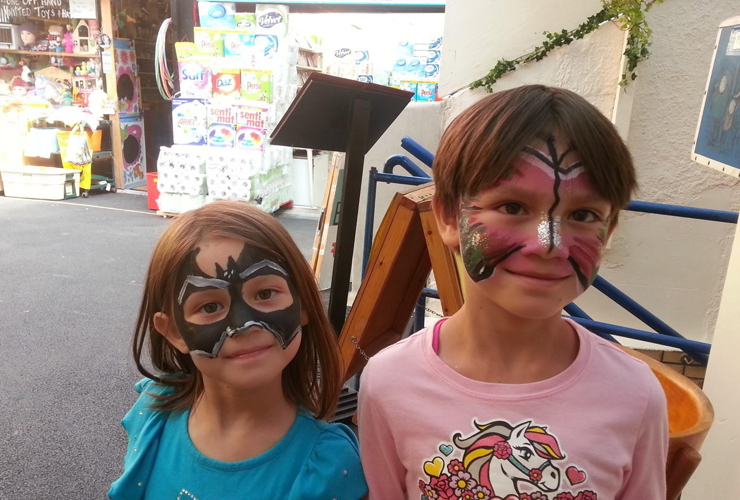 The kids modelling some free face painting at Blackrock Market.